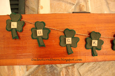 Eclectic Red Barn: Luck Shamrock banner on fireplace mantel