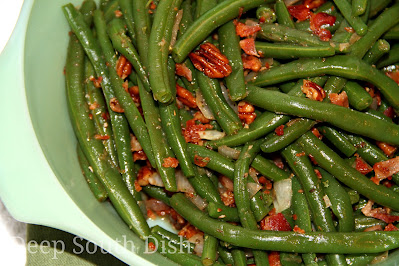 Fresh green beans, blanched then seasoned with onion, garlic and herbs, and tossed with bacon and pecans and a browned butter pan sauce.