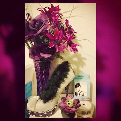 witches altar to personal empowerment featuring glittery stiletto Muses Mardi Gras shoe throw, black purple flowers, dark purple succulent and little katherine hepburn puzzle box