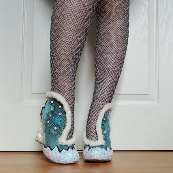 wearing blue PU booties with white glitter front and fur trimmed top