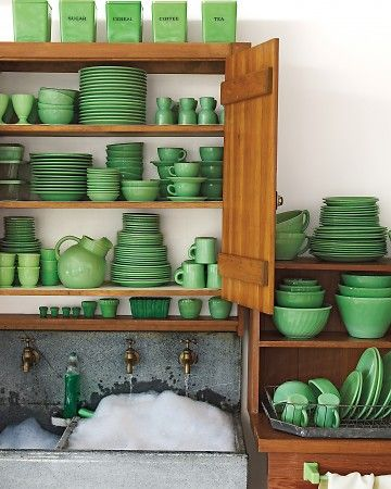 green jadeite dishes on wood shelves