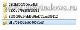На диске Д появились папки с набором букв и цифр.