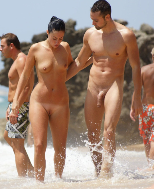 Black couple on nudist beach