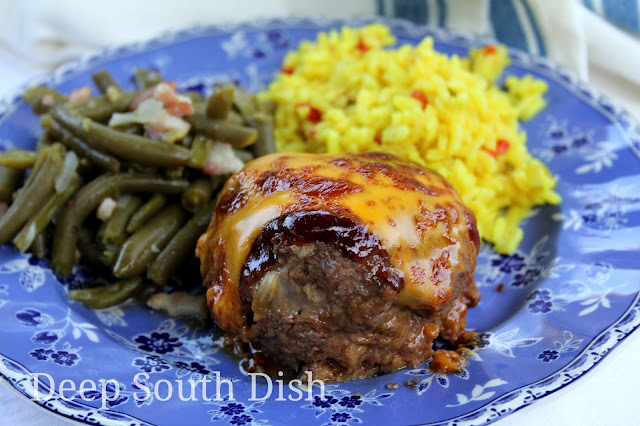 Mini meatloaves, made in a jumbo, Texas style muffin pan, with lean ground beef, the Trinity of veggies, barbecue sauce, topped with a brown sugar, Creole mustard barbecue glaze and finished with cheese.