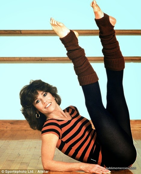 Jane Fonda in tights and striped leotard working out