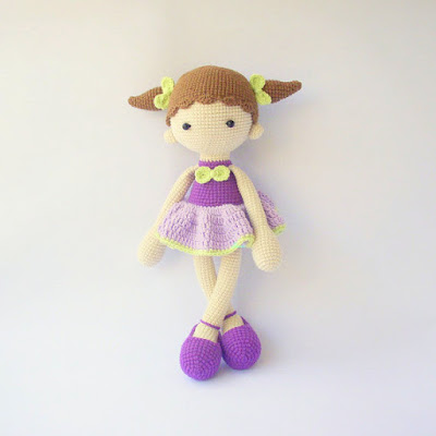 Colorful crochet amigurumi doll girl with pig tails and dress