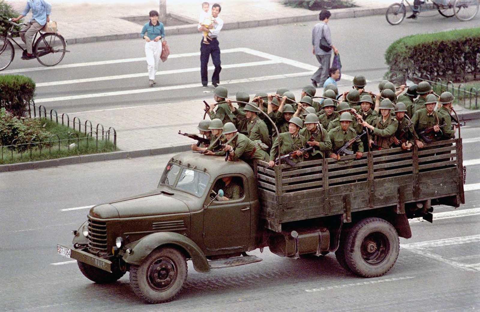 A truck drives Chinese soldiers down Chang'an Boulevard in Beijing, on June 5, 1989, one day after violence between government troops and pro-democracy protesters left hundreds dead.