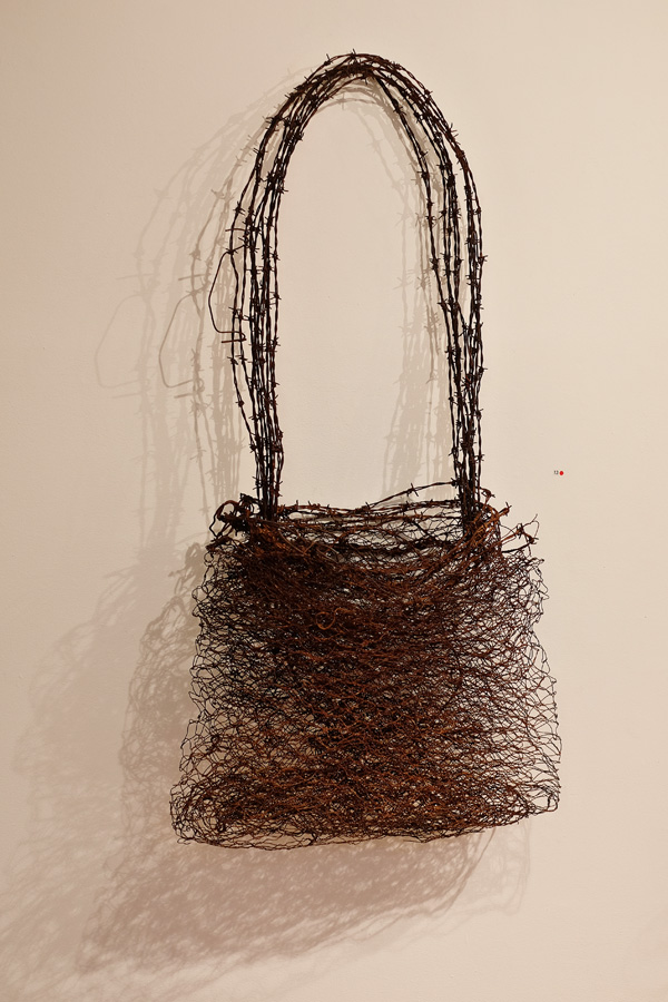 Bag made from chicken wire with barbed wire strap Narrbong-Galang by Lorraine Connelly-Northey - Photography by Kent Johnson for Street Fashion Sydney