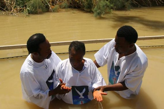 Pictures: Prophet Joshua Iginla baptizes his mother at River Jordan in Israel
