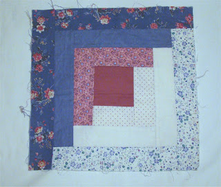 Blue and pink log cabin block with light and dark fabrics