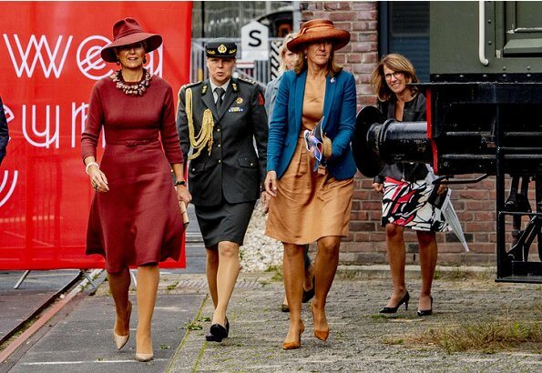 Queen Maxima wore Natan burgundy belted midi dress, and Delvigne hat, Natan pumps
