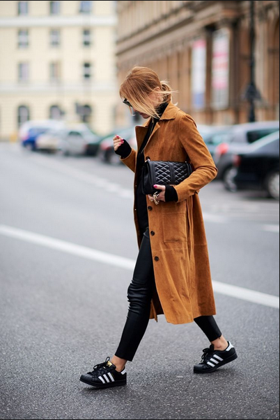 adidas sneakers with leather pants and camel coat