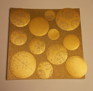 Gold card square with gold vellum circles covering it