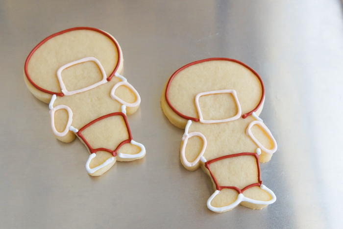 step-by-step tutorial for making football player cookies
