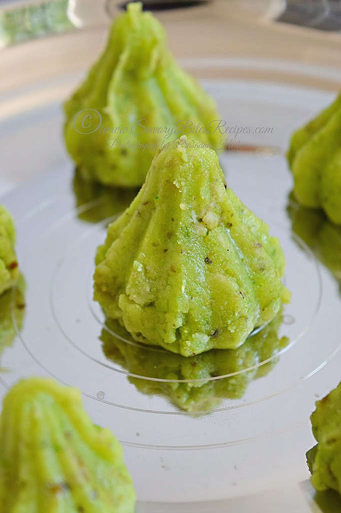 Front look of silver plate having Pistachio Modak