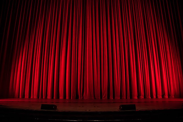 Red Curtain | Photo by Rob Laughter via Unsplash