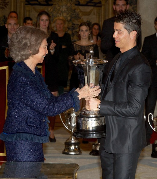 Queen Sofia presents Real Madrid's player Cristiano Ronaldo with the Ibero-American Community Trophy