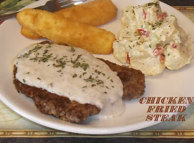 chicken fried steak with cornbread and potato salad photo by candy dorsey
