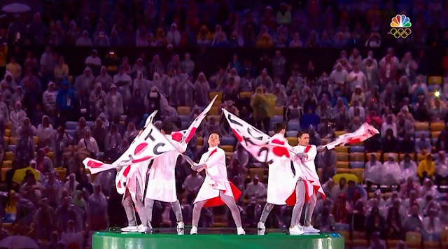 Japanese flag Tokyo bearing men warp pipe costumes Rio 2016 Olympic Games Closing Ceremony