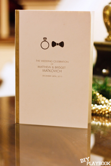 This wedding booklet with gold ribbon is elegant and simple.