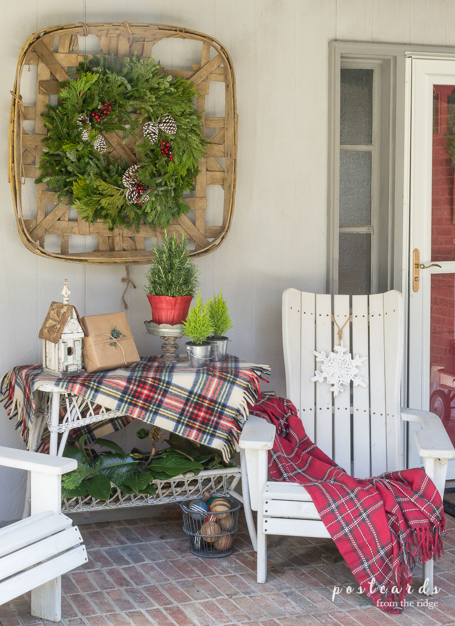 front porch with white chairs and Christmas decor