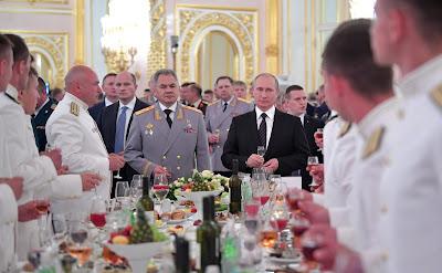 Russian President Vladimir Putin and Defense MinisterSergei Shoigu.