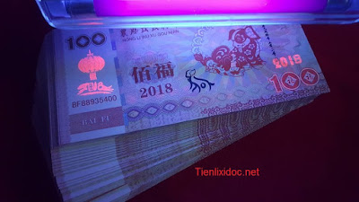 Tiền Con Chó Macao 100 patacas bảo an chống giả