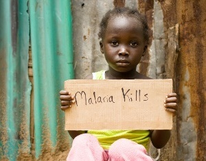 Kid holding malaria kills banner