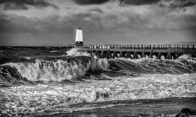 Photo of big waves rolling onto the shore at Maryport