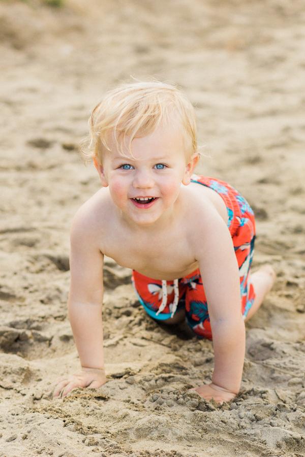 blonde-haired, blue-eyed toddler / Gap Kids swim trunks