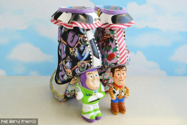 left back angle of ankle boots with Toy Story character heels and sky wallpaper background