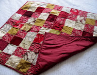 Red and gold silk and velvet quilt