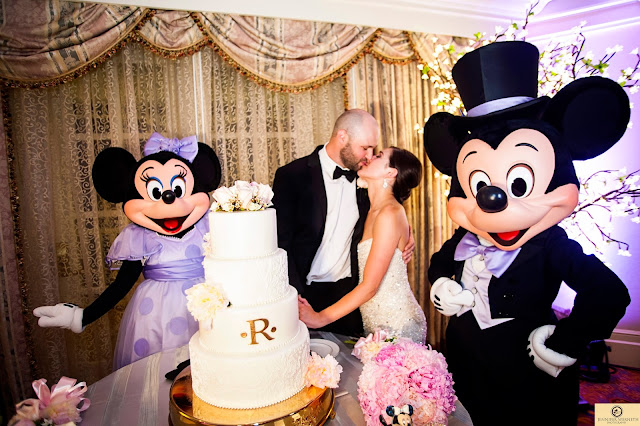 Disney World Wedding Photography cake cutting Mickey and Minnie
