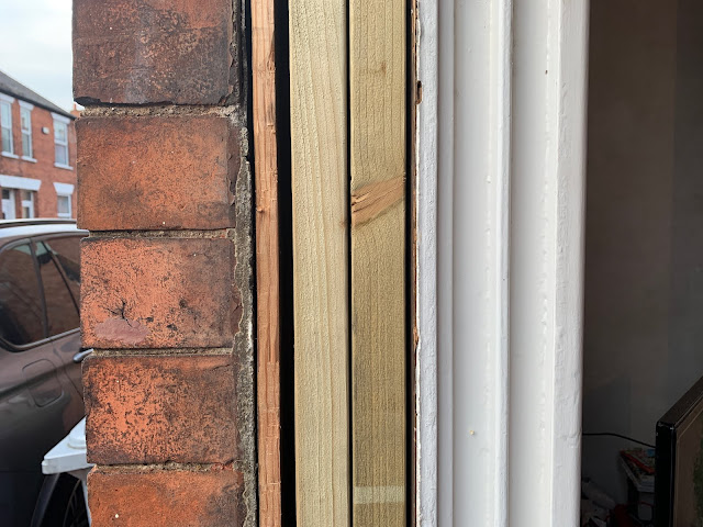filling in old sash window frame