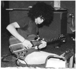 Slash and his guitar in Slash Autobiography PDF Download