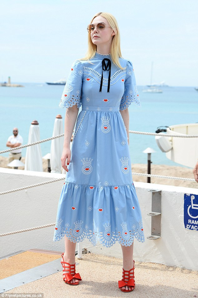 Elle Fanning walks around Cannes in quirky frock