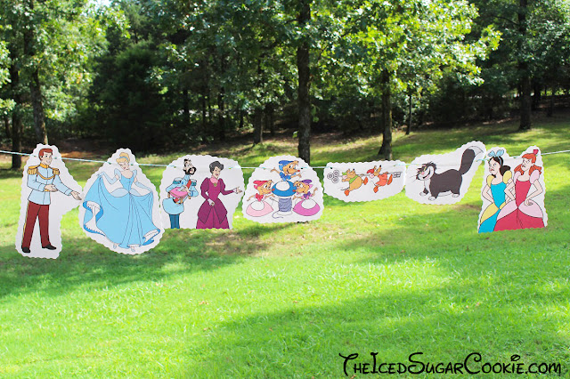 DIY Cinderella Birthday Party Banner Ideas- Disney Characters Prince Charming, Stepmother Lady Tremaine, Drizella, Anastasia, The Grand Duke, Gus, Jaq, Mary, Suzy, Perla, Lucifer Cat The Iced Sugar Cookie