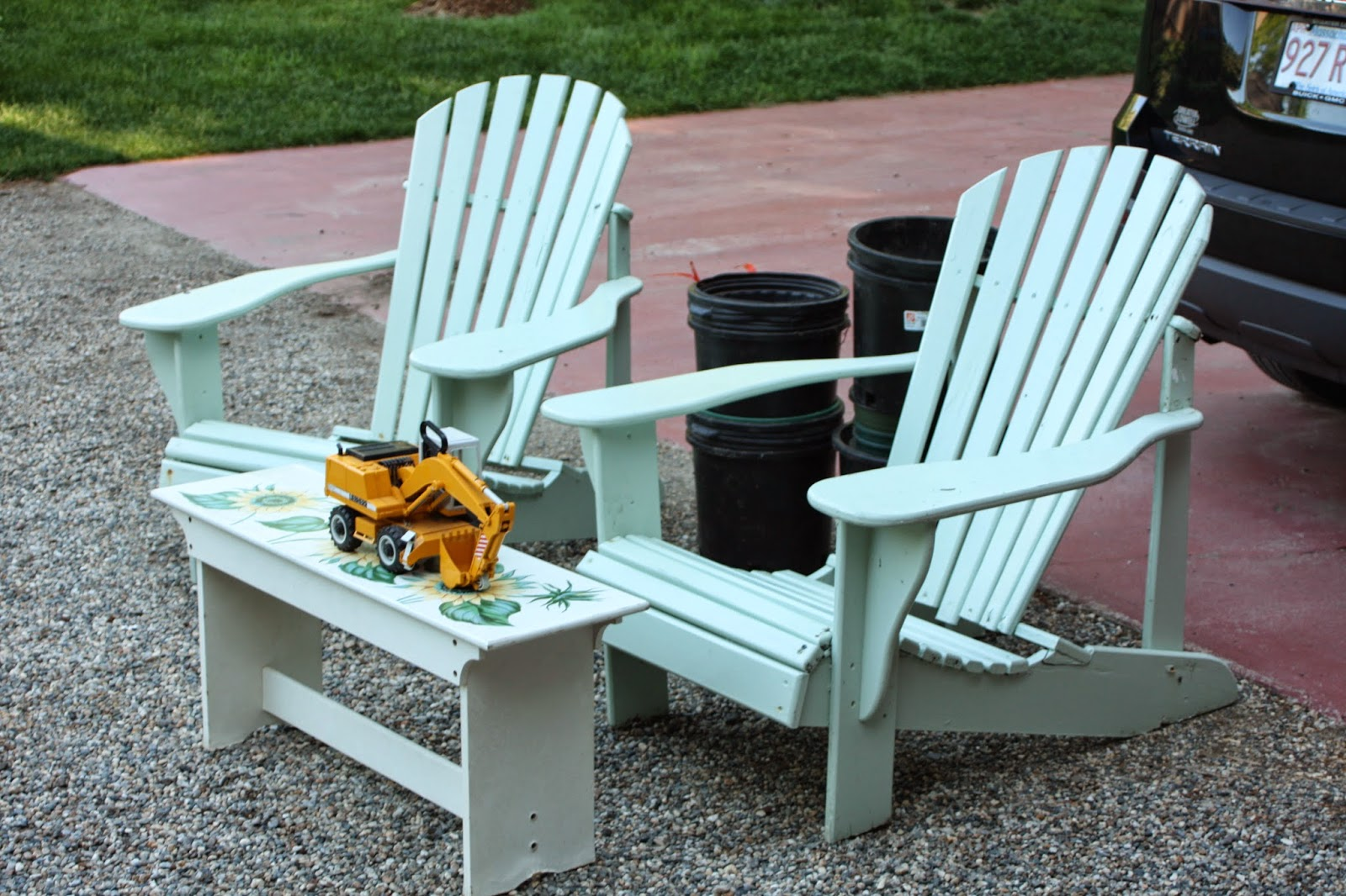 adirondack chairs bench table garden