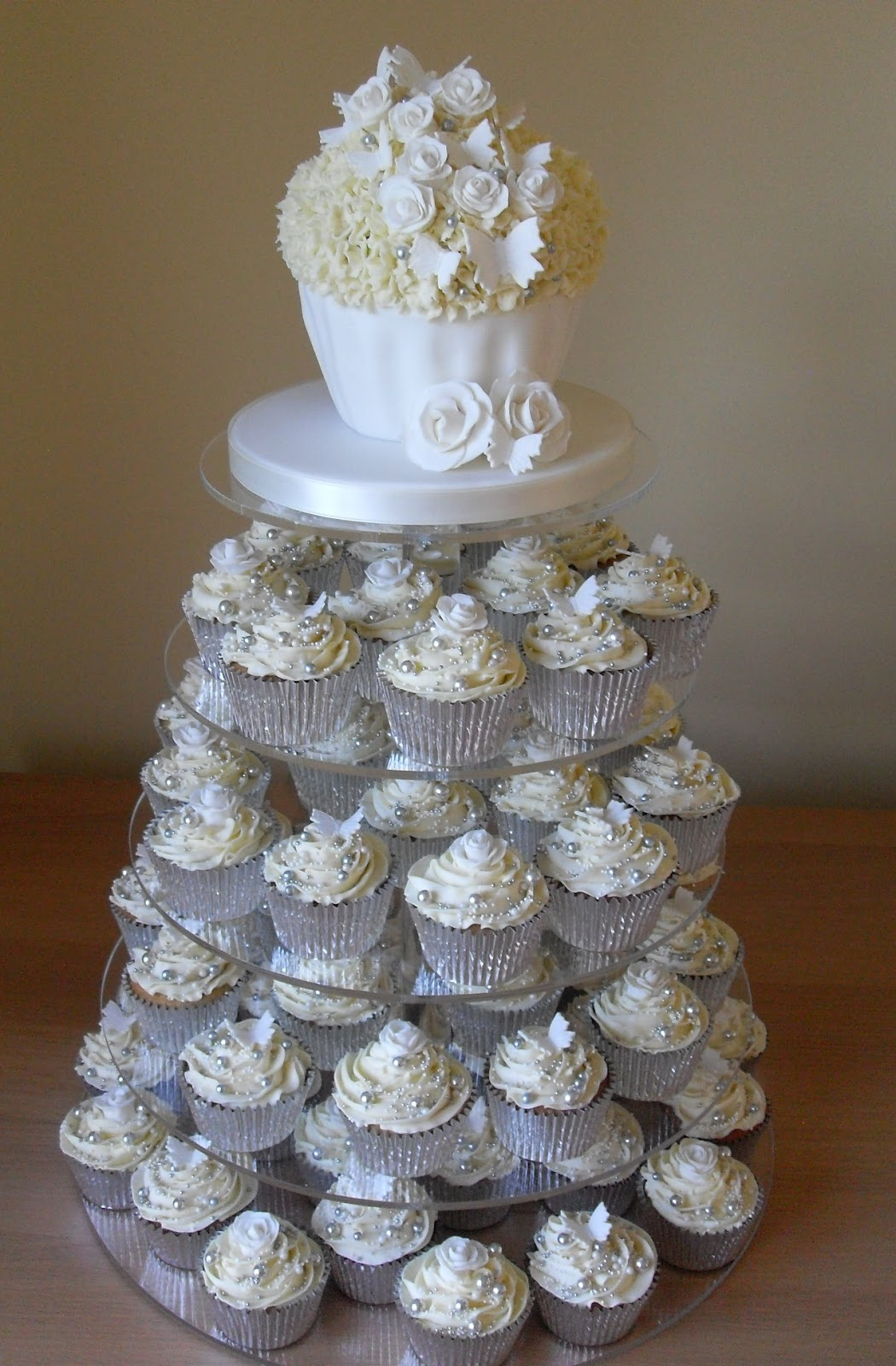 white and silver cupcake tower. Black Bedroom Furniture Sets. Home Design Ideas