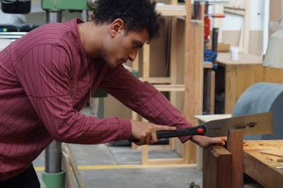 Man using a Japanese saw