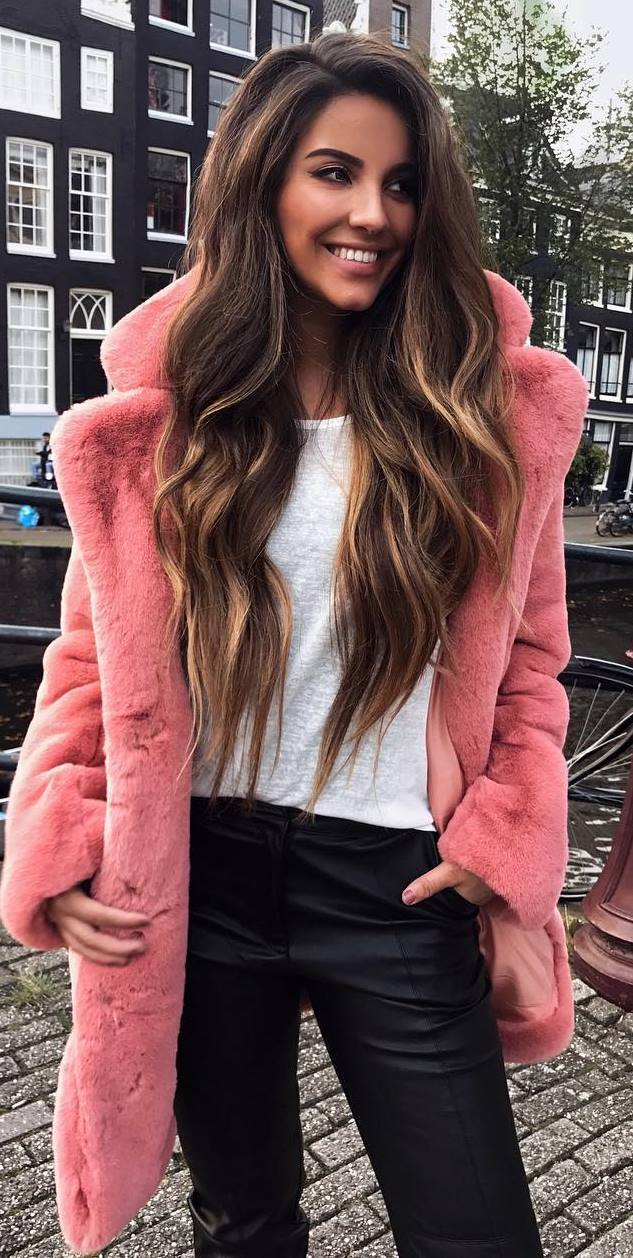 what to wear with a pink fur coat : tee and black pants