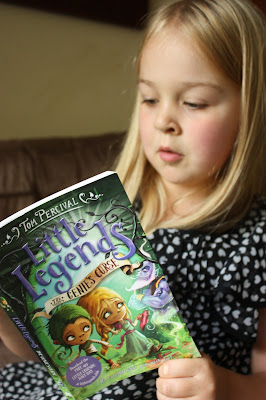 Reading Little Legends books by Tom Percival