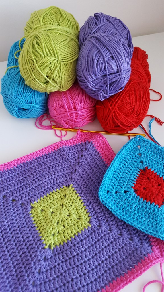 Looking for bright bold colour-block crochet blanket ideas?  Read more to see the start of one!