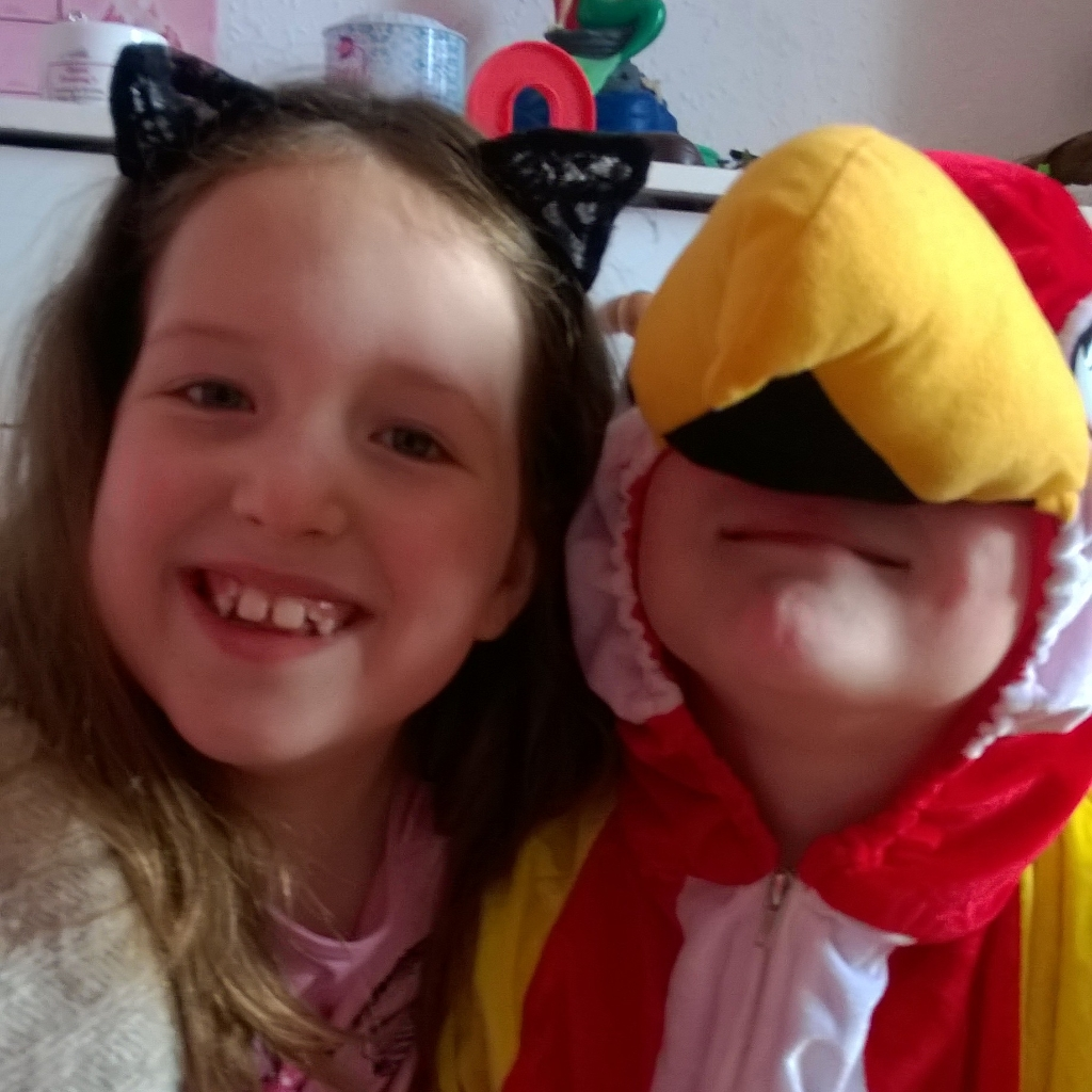 going too far with our children's after-school activities-Caitlin and Ieuan in his parrot costume