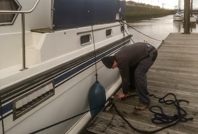 Photo of Phil adjusting one of the creaking mooring ropes