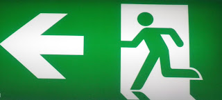 LEFT EXIT SIGN