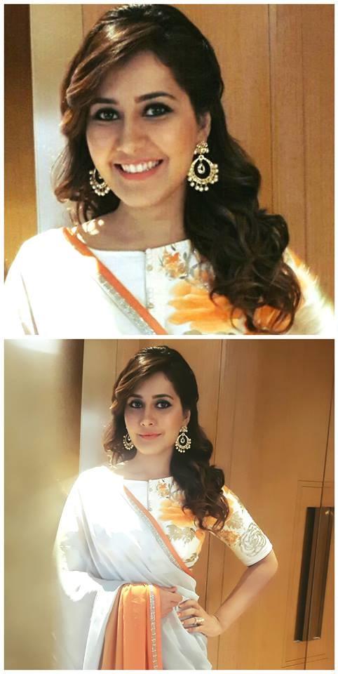 South Indian Hot Actress Rashi Khanna Latest Stills In Orange Saree