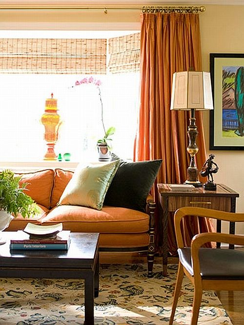 Traditional Living Room With Orange Couch And Curtains