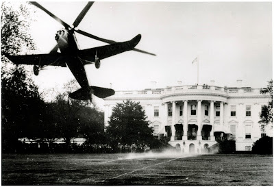 One-half left front view from slightly below of Pitcairn PCA-2 Autogiro (r/n NC 10761; c/n B-7) taking off from the South Lawn of the White House in Washington, D.C.