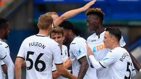 Swansea City FC players celebrate goal